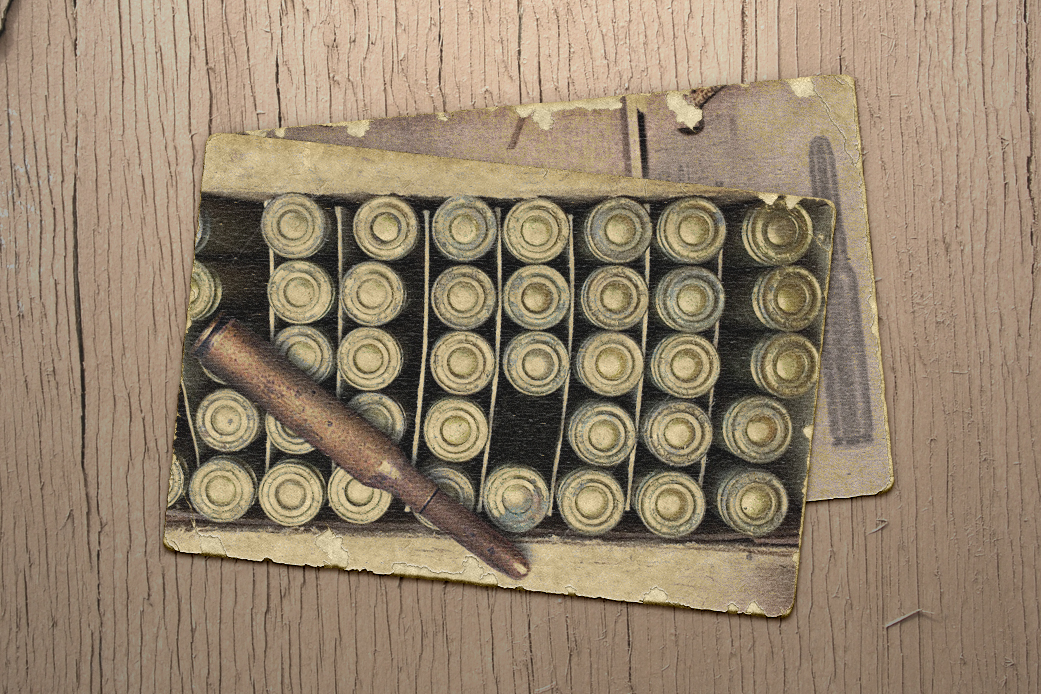 Box of large-caliber rifle bullets