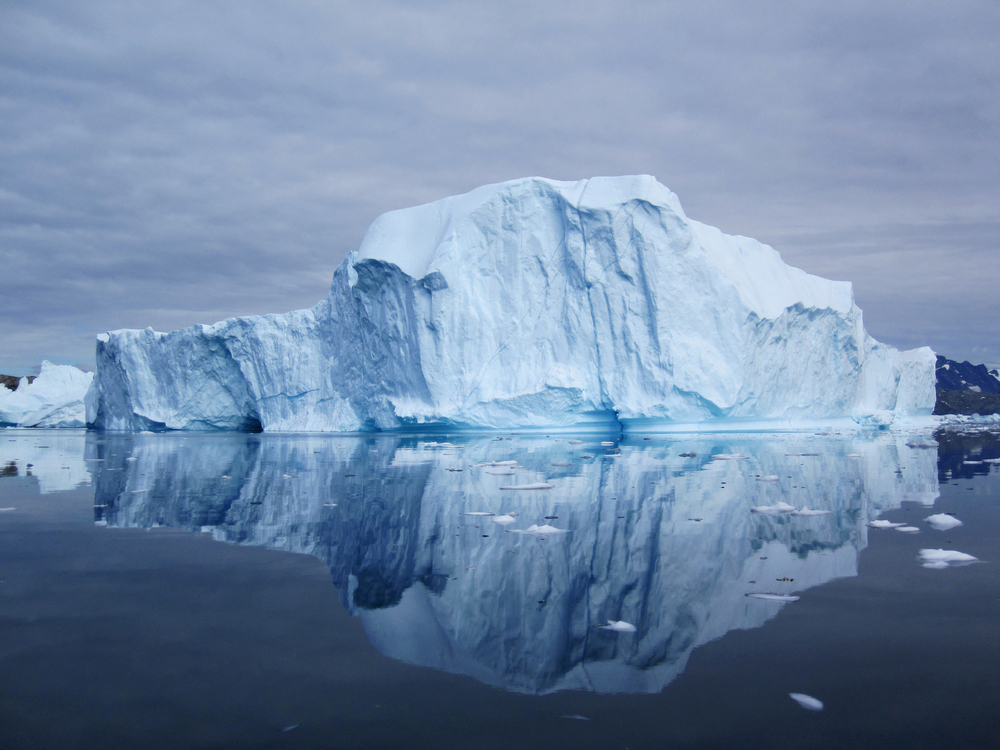 Large iceberg reflected in water