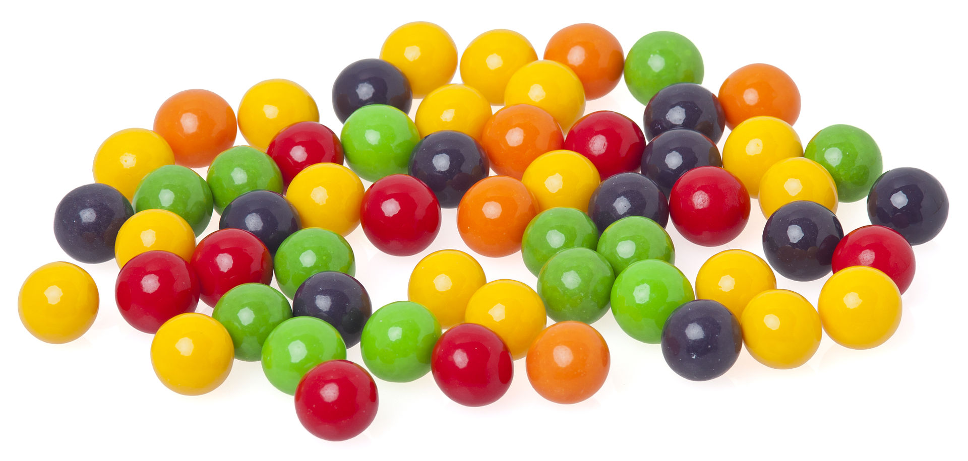 several bits of candy in yellow, red, green, orange and purple