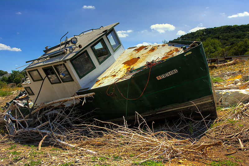 Large boat rests in dry lake bed