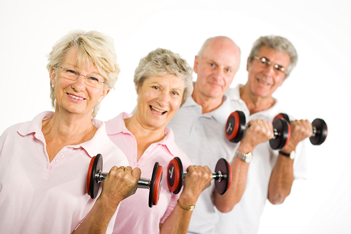 two women and two men lift small dumbbells with left arms