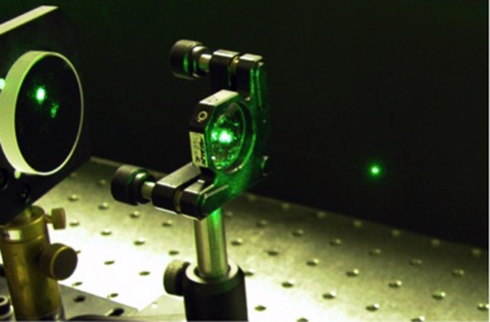 a laser suspends a tiny sphere of glass