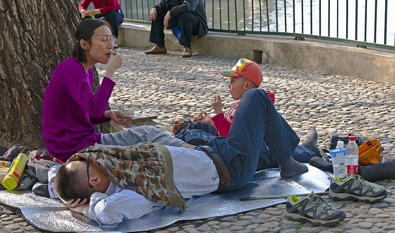 family of three having a picnic