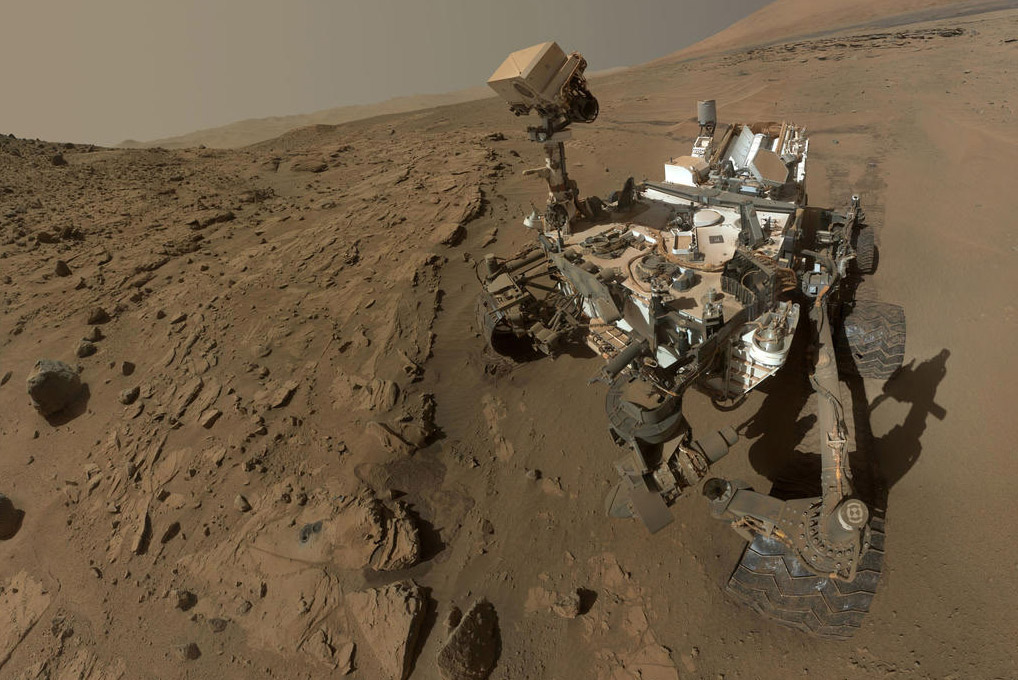 Depiction of NASA rover on surface of Mars