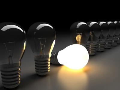 row of light bulbs with one lit