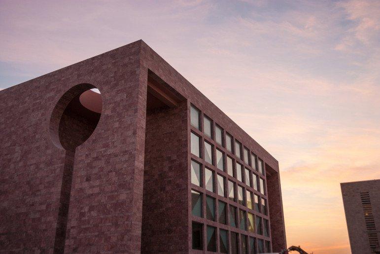 corner of building set against the sky