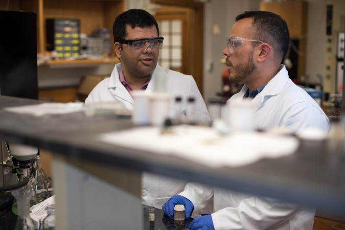 Two men in laboratory engage in conversation