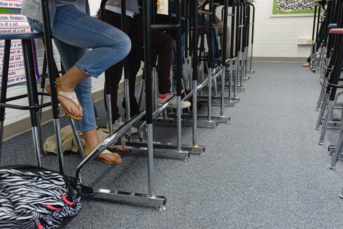 students legs under standing desks