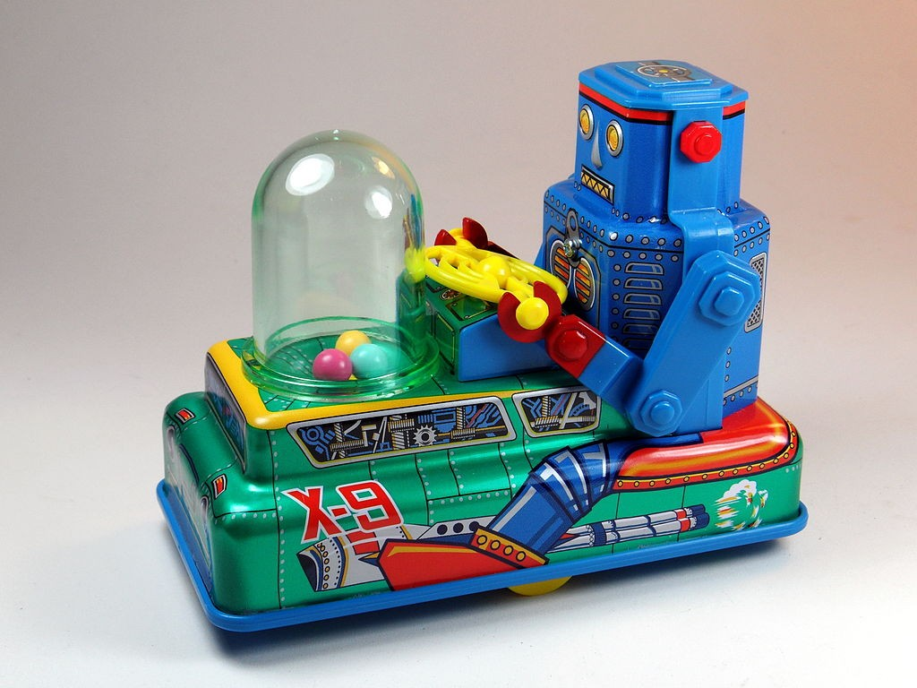 a toy car with a robot at the wheel