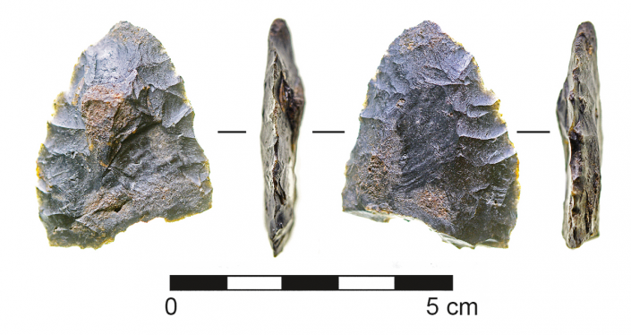 a prehistoric stone knife show from four angles