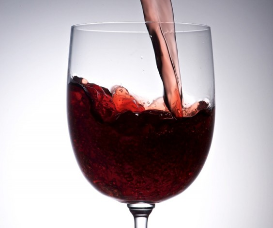 wine pours into a wine glass