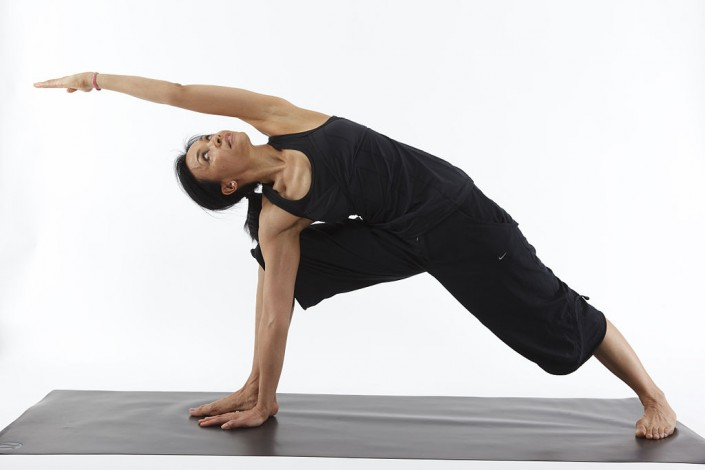 woman performs a stretching exercise