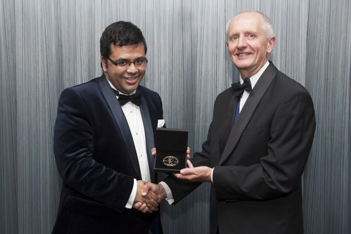 Man receives award from another man