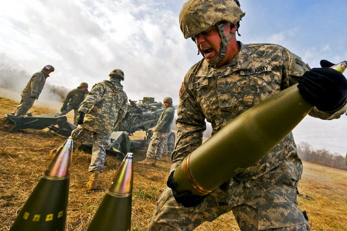 U.S. Army private lifts a 155mm round weighing about 100 pounds at Camp Atterbury Joint Maneuver Training Center in central Indiana on Nov. 4, 2010. Futrell and soldiers assigned to his Indiana National Guard unit fired the round from an M777 Howitzer, which was recently issued to the Indiana Guard.