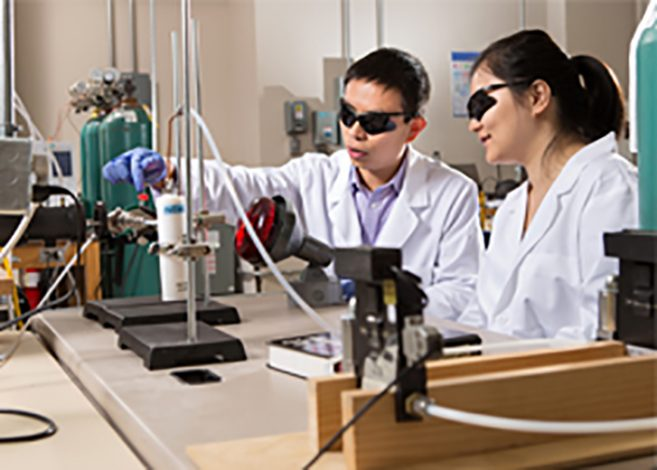 engineers work with lab equipment