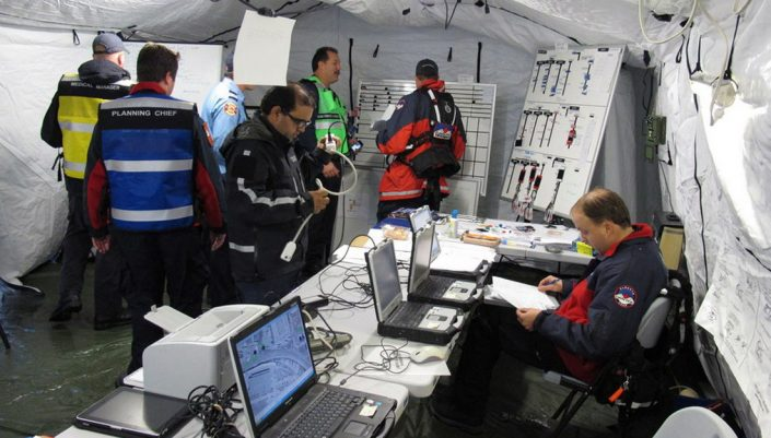 Early responders prepare in a makeshift headquarters