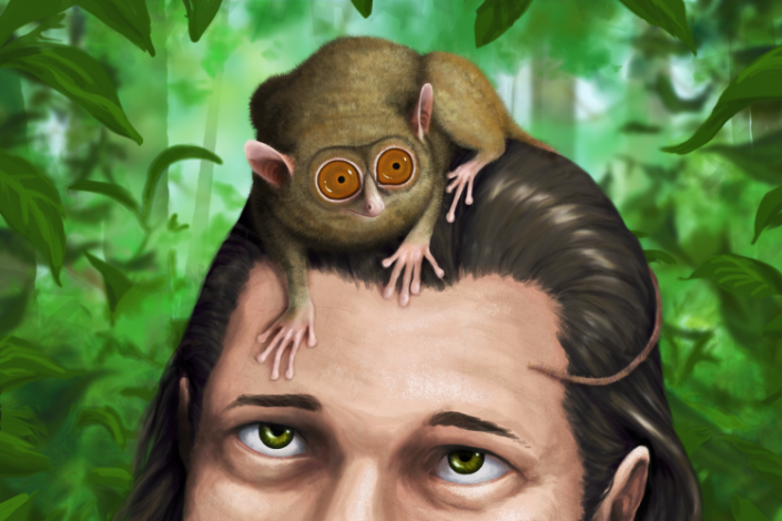 A small animal on a woman's head