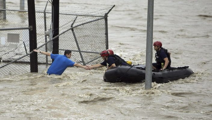 Emergency workers attempt to rescue man from flood waters