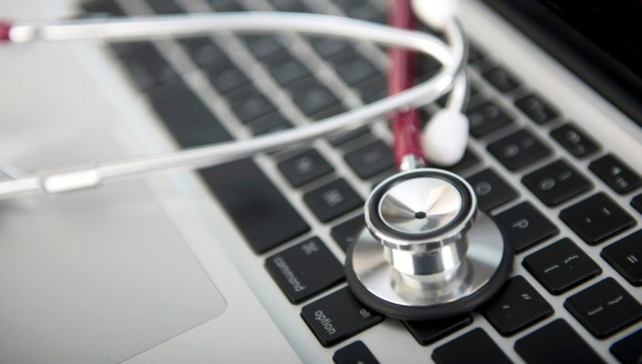 A stethoscope on a computer keyboard