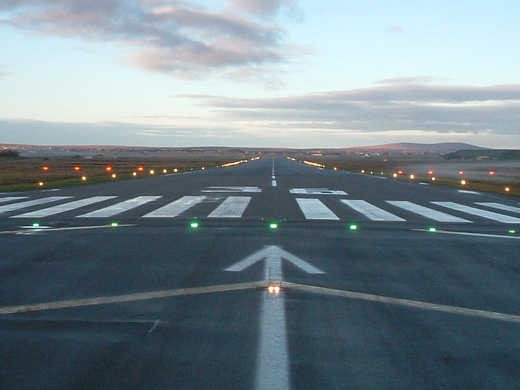 A view of a plane approaching a runway