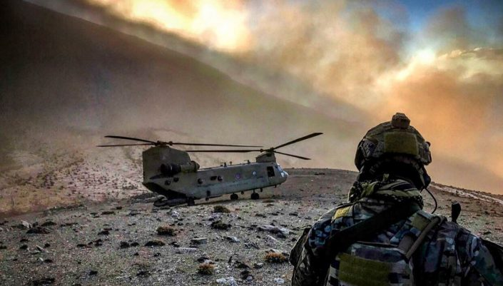 US soldier faces a helicopter