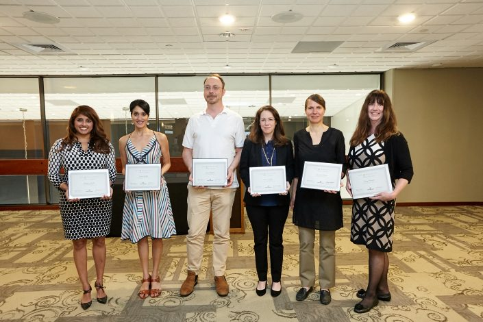 Five women and one man holding certificates
