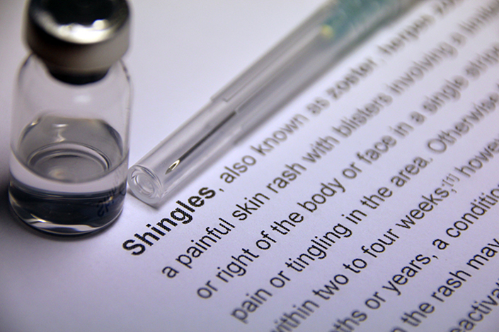 A dictionary open to the definition of shingles