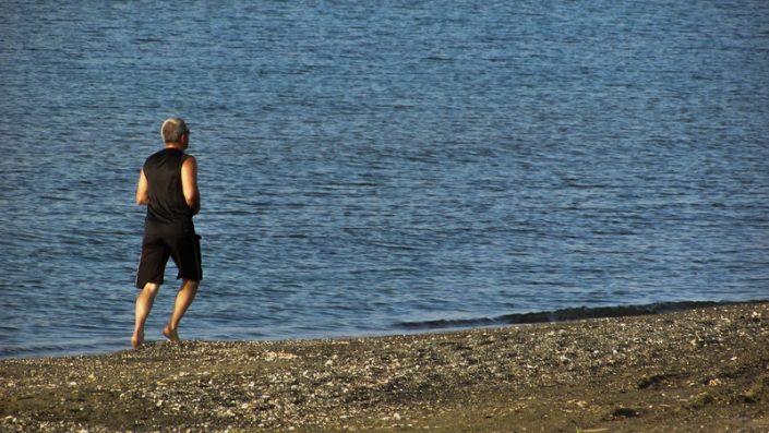 A man jogging on a beach
