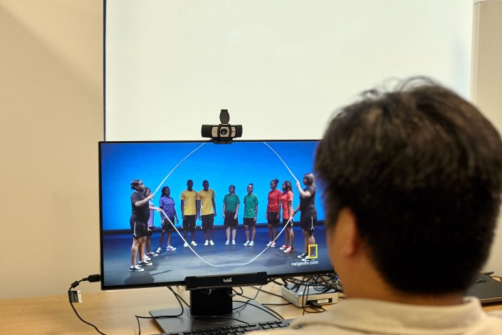 Test subject watches screen while monitored by human-behavior techonology