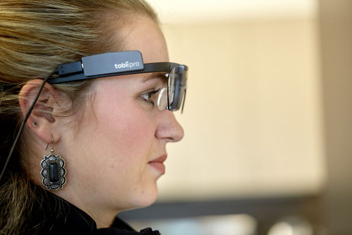 sideview of woman wearing eye-tracking technology